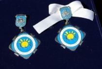 28 новгородских семей получили почётные знаки и медали