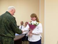 Александр Бастрыкин наградил «За службу закону» многодетную маму Дину Пальчук и ее коллегу Алексея Черноперова