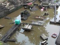 Фотофакт: археологический раскоп в Великом Новгороде затопил проливной дождь